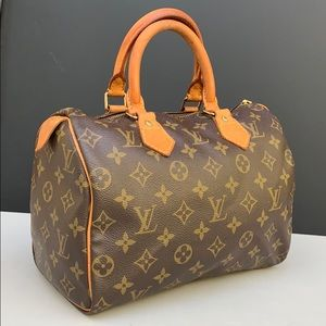 Louis Vuitton speedy 25 handbag.